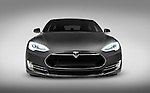 Gray 2017 Tesla Model S luxury electric car front view isolated on gray background with clipping path Image © MaximImages, License at https://www.maximimages.com
