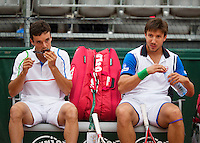 France, Paris, 28.05.2014. Tennis, French Open, Roland Garros, Roberto Bautista Agut (ESP) with his doubles partner Igor Sijsling (NED) (R)<br /> Photo:Tennisimages/Henk Koster