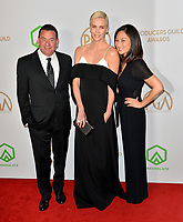 SANTA MONICA, USA. January 18, 2020: A.J. Dix, Charlize Theron & Beth Kono at the 2020 Producers Guild Awards at the Hollywood Palladium.<br /> Picture: Paul Smith/Featureflash