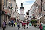 Austria, Lower Austria, UNESCO World Heritage Wachau, Krems: Old Town, pedestrian area Obere Landstrasse, at background medieval town gate Steinertor