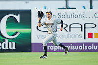Charleston RiverDogs center fielder Jake Cave (6) makes a running catch during the South Atlantic League game against the Greensboro Grasshoppers at NewBridge Bank Park on July 17, 2013 in Greensboro, North Carolina.  The Grasshoppers defeated the RiverDogs 4-3.  (Brian Westerholt/Four Seam Images)