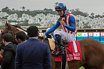 DEL MAR, CA. AUGUST 12:  #1 Run Away ridden by Flavien Prat, receive congratulations from trainer Simon Callaghan and owner Kaleem Shah after winnning the Best Pal Stakes (Grade ll) on August 12, 2017, at Del Mar Thoroughbred Club in Del Mar, CA. (Photo by Casey Phillips/Eclipse Sportswire/Getty )