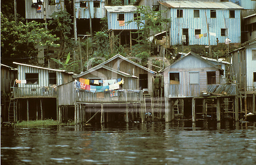 Manaus, Brazil. Poor shanty town housing; houses built on stilts to accomodate rise and fall in water level. Amazonas State.