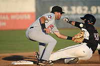 Cullen Large (6) of the Vancouver Canadians can't handle the throw as Rob Calabrese (43) of the Salem-Keizer Volcanoes slides into second base during a game at Volcanoes Stadium on July 24, 2017 in Keizer, Oregon. Salem-Keizer defeated Vancouver, 4-3. (Larry Goren/Four Seam Images)