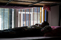 A visually impaired Tibetan student rests at the boys' dormitory of the School for the Blind in Tibet, in the capital city of Lhasa, September 2016.
