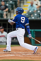 Oklahoma City Dodgers second baseman Darnell Sweeney (9) follows through on his swing during the Pacific Coast League baseball game against the Nashville Sounds on June 12, 2015 at Chickasaw Bricktown Ballpark in Oklahoma City, Oklahoma. The Dodgers defeated the Sounds 11-7. (Andrew Woolley/Four Seam Images)