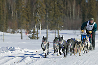 Musher Eric Lanser on day three of the oldest continuously run sled dog race in the world, the 2003 Open North American Sled dog championships, Fairbanks, Alaska. The annual race consists of three daily races, the combined fastest time wins.