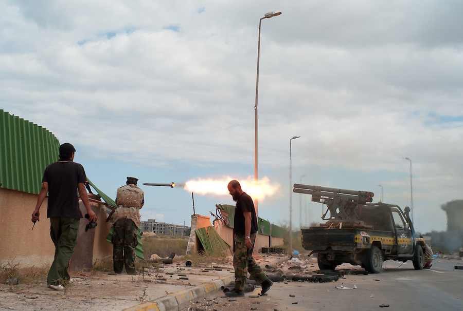 Anti-Gaddafi fighters fire Grad rockets towards Gaddafi loyalist position in Sirte, Libya.