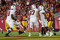 LOS ANGELES, CA - SEPTEMBER 11: Myles Hinton #78, Bradley Archer #87 and Nathaniel Peat #8 of the Stanford Cardinal celebrate after an 87 yard  touchdown run by Nathaniel Peat during a game between University of Southern California and Stanford Football at Los Angeles Memorial Coliseum on September 11, 2021 in Los Angeles, California.