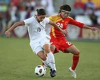 Ali Krieger #16 of the USA WNT turns the ball away from Yasha Gu #24 of the PRC WNT during an international friendly match at KSU Soccer Stadium, on October 2 2010 in Kennesaw, Georgia. USA won 2-1.