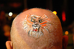 A tiger on the head of Howard Startzman at the San Luis Mardi Gras Ball in Galveston Friday Feb. 01,2008.(Dave Rossman/For the Chronicle)