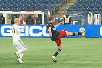 FOXBOROUGH, MA - NOVEMBER 1: Adam Buksa #9 of New England Revolution reverses the ball as Erik Sorga #50 of DC United comes in to tackle during a game between D.C. United and New England Revolution at Gillette Stadium on November 1, 2020 in Foxborough, Massachusetts.