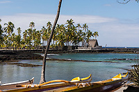Pu'uhonua o Honaunau, an historic place of refuge and also a national historical park, seen from an outrigger canoe, south Kona, Big Island of Hawai'i.