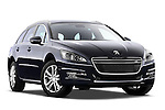 Low aggressive passenger side front three quarter view of 2012 Peugeot 508 SW Allure Wagon Stock Photo