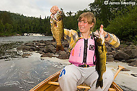 Young girl fishing for bass
