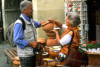 Tourists shopping in romantic Tuscany in Greve in Chianti Ital