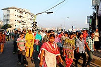 Workers make their way to work to their textile factories in Dhaka.