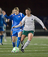 Boston Breakers forward-midfielder Kelly Smith (10) and St Louis Athletica midfielder Lisa Stoia (7) do battle. The Boston Breakers defeated Saint Louis Athletica, 2-0, at Harvard Stadium on April 11, 2009.