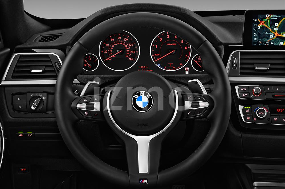 Car pictures of steering wheel view of a 2018 BMW 3 Series 330i GT M Sport 5 Door Hatchback