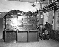 Three BD-110A switchboards on left and one BD-96 on extreme right being operated by Pfc. James Grahn of Co. B, 71st Sig. Svc. Bn., Pusan, Korea.  August 1, 1950.  Cpl. Crowe. (Army)<br /> NARA FILE #:  111-SC-344946<br /> WAR & CONFLICT BOOK #:  1408