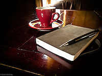 Notebook and Espresso cup at a coffee shop at the M50 Art Community in Shanghai.