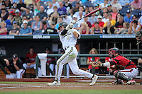 Dansby Swanson #7 of the Vanderbilt Commodores bats during Game 2 of the 2014 Men's College World Series between the Vanderbilt Commodores and Louisville Cardinals at TD Ameritrade Park on June 14, 2014 in Omaha, Nebraska. (Brace Hemmelgarn/Four Seam Images)