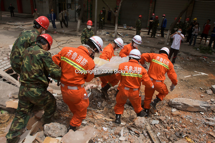 Rescuers deploy heavy machine to cut steel reinforcement of a collapsed building and discover a dead woman on the sixth day after the 8 magnitude earthquake in Mianzhu, Sichuan, China. The earthquake happened at 14:28pm on 12 May 2008, with the epicenter in Wenchuan County, about 159km NW of Chengdu, Sichuan, China.