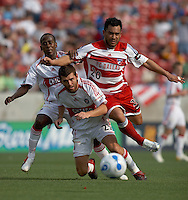 FC Dallas forward, Carlos Ruiz (#20), takes the ball over the top of Chicago Fire defender, Gonzalo Segares (#25).   FC Dallas beat the Chicago Fire 3-2 in the season opener on April 1, 2006 at Pizza Hut Park in Frisco, TX.