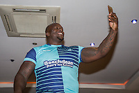 "Wycombe Wanderers new signing, Adebayo Akinfenwa, aka ""The Beast"", takes a selfie as he is unveiled during the 2016/17 Kit Launch of Wycombe Wanderers to the public at Adams Park, High Wycombe, England on 10 July 2016. Photo by David Horn."