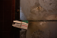 Mail hangs on the door of the permanently closed Pepe Bocca Napoli restaurant and deli in Davis Square in Somerville, Massachusetts, on Tue., Jan. 26, 2021. The deli had reopened as a restaurant and then permanently closed in 2018. Looking through windows, the interior is completely empty.