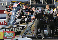 Feb. 14, 2013; Pomona, CA, USA; NHRA crew members for top fuel dragster driver Brittany Force during qualifying for the Winternationals at Auto Club Raceway at Pomona.. Mandatory Credit: Mark J. Rebilas-