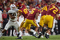 LOS ANGELES, CA - SEPTEMBER 11: Stephen Herron #15 of the Stanford Cardinal attempts to get away from Kobe Pepe #94 of the USC Trojans during a game between University of Southern California and Stanford Football at Los Angeles Memorial Coliseum on September 11, 2021 in Los Angeles, California.