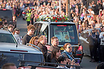 Fans watch the funeral cortege of the late Prodigy singer Keith Flint makes its way through the packed streets of Bocking,  Braintree, Essex today on route to  St Marys Church .