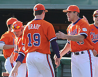 Starting pitcher Kevin Brady (19) of the Clemson Tigers is congratulated after a scoreless inning in a game against the University of Alabama-Birmingham on Feb. 17, 2012, at Doug Kingsmore Stadium in Clemson, South Carolina. UAB won 2-1. (Tom Priddy/Four Seam Images)
