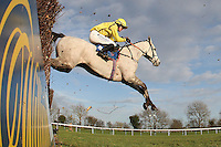 Clash Duff ridden by Nick Scholfield jumps the last fence on the way to winning the Connolly's Red Mills Racecourse Cubes Novices' Chase at Huntingdon Racecourse, Brampton, Cambridgeshire - 27/01/12 - MANDATORY CREDIT: Gavin Ellis/TGSPHOTO - Self billing applies where appropriate - 0845 094 6026 - contact@tgsphoto.co.uk - NO UNPAID USE.