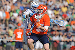 Baltimore, MD - March 17: Midfielder Marshall Burkhart #28 Hopkins defends Midfielder Bobby Eilers #30 of the Syracuse Orangemen during the Syracuse v Johns Hopkins mens lacrosse game at  Homewood Field on March 17, 2012 in Baltimore, MD.(Ryan Lasek/Eclipse Sportswire)