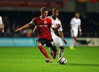 Pictured: Luke Moore of Swansea (R) challenging John Stone of Barnsley (L). Tuesday 28 August 2012<br /> Re: Capital One Cup game, Swansea City FC v Barnsley at the Liberty Stadium, south Wales.