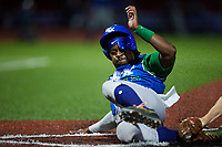 Tillman Pugh (15) of the Lexington Legends is tagged out trying to score on a wild pitch during the game against the High Point Rockers at Truist Point on June 16, 2021, in High Point, North Carolina. The Legends defeated the Rockers 2-1. (Brian Westerholt/Four Seam Images)