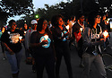 Tulane, Loyola and Dillard students come together for Take Back the Night, a candlelight walk to protest rape and violence against women.