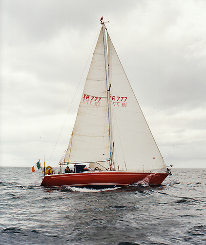 Witchcraft on passage from Kinsale to Glandore during the 1996 Cruise-in-Company, showing the successful slightly luminous topside finish she was given as an experiment by a classic car paintwork expert. Although she carried the heavy ground tackle expected of a 40-footer, as the anchor winch and chainlocker below it were at the mast, there was little or no adverse effect on performance. Photo: Kevin Dwyer