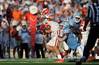 CHAPEL HILL, NC - SEPTEMBER 28: Trevor Lawrence #16 of Clemson University is tackled by Chazz Surratt #21 of the University of North Carolina during a game between Clemson University and University of North Carolina at Kenan Memorial Stadium on September 28, 2019 in Chapel Hill, North Carolina.