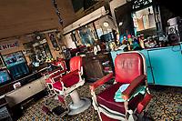 Old fashioned armchairs are seen empty in a vintage barber shop in San Salvador, El Salvador, 14 May 2011.