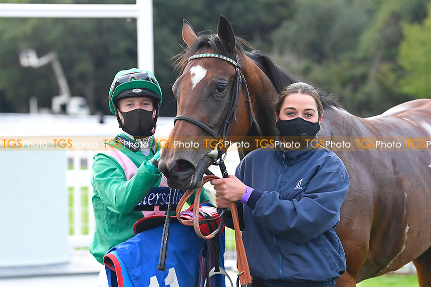 Winner of The Venture Security Handicap Stakes Molly Shaw (11, green) ridden by Jack Mitchell and trained by Chris Wall in the Winners enclosure during Horse Racing at Salisbury Racecourse on 11th September 2020