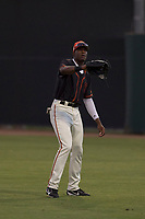 AZL Giants Black right fielder Kwan Adkins (8) warms up between innings of an Arizona League game against the AZL Athletics at the San Francisco Giants Training Complex on June 19, 2018 in Scottsdale, Arizona. AZL Athletics defeated AZL Giants Black 8-3. (Zachary Lucy/Four Seam Images)