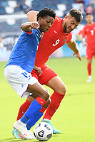 KANSAS CITY, KS - JULY 15: Dutherson Clervaux #15 of Haiti ,Lucas Cavallini #9 of Canada during a game between Canada and Haiti at Children's Mercy Park on July 15, 2021 in Kansas City, Kansas.