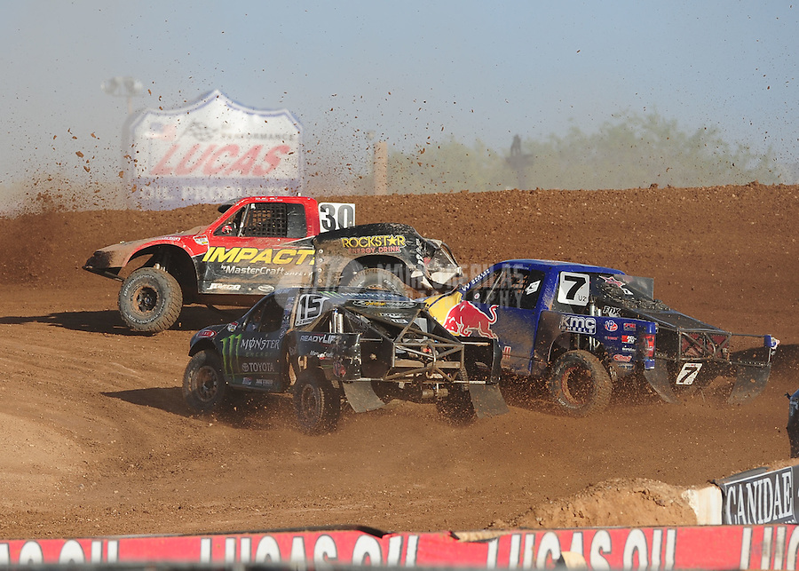 Apr 17, 2011; Surprise, AZ USA; LOORRS driver Marty Hart (15) races with Robbie Pierce (30) and Bryce Menzies (7) during round 4 at Speedworld Off Road Park. Mandatory Credit: Mark J. Rebilas-