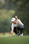 Matthew Fitzpatrick of England places his ball during Hong Kong Open golf tournament at the Fanling golf course on 25 October 2015 in Hong Kong, China. Photo by Aitor Alcade / Power Sport Images