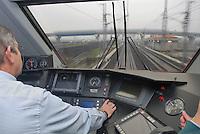 """- inside of the driver's compartment on an high-speed  train  Eurostar """"Red Arrow"""" on the Milan-Bologna  railway line....- interno della cabina di guida di un treno ad alta velocità Eurostar """"Freccia Rossa"""" sulla linea Milano-Bologna"""