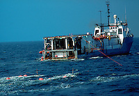 Seismic boat conducting survey for oil exploration