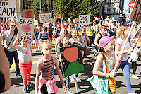 Pictured: Saturday 17 September 2016<br /> Re: Roald Dahl's City of the Unexpected has transformed Cardiff City Centre into a landmark celebration of Wales' foremost storyteller, Roald Dahl, in the year which celebrates his centenary.<br /> Protesters, in support of the Giant Peach pictured on Westgate Street, Cardiff.